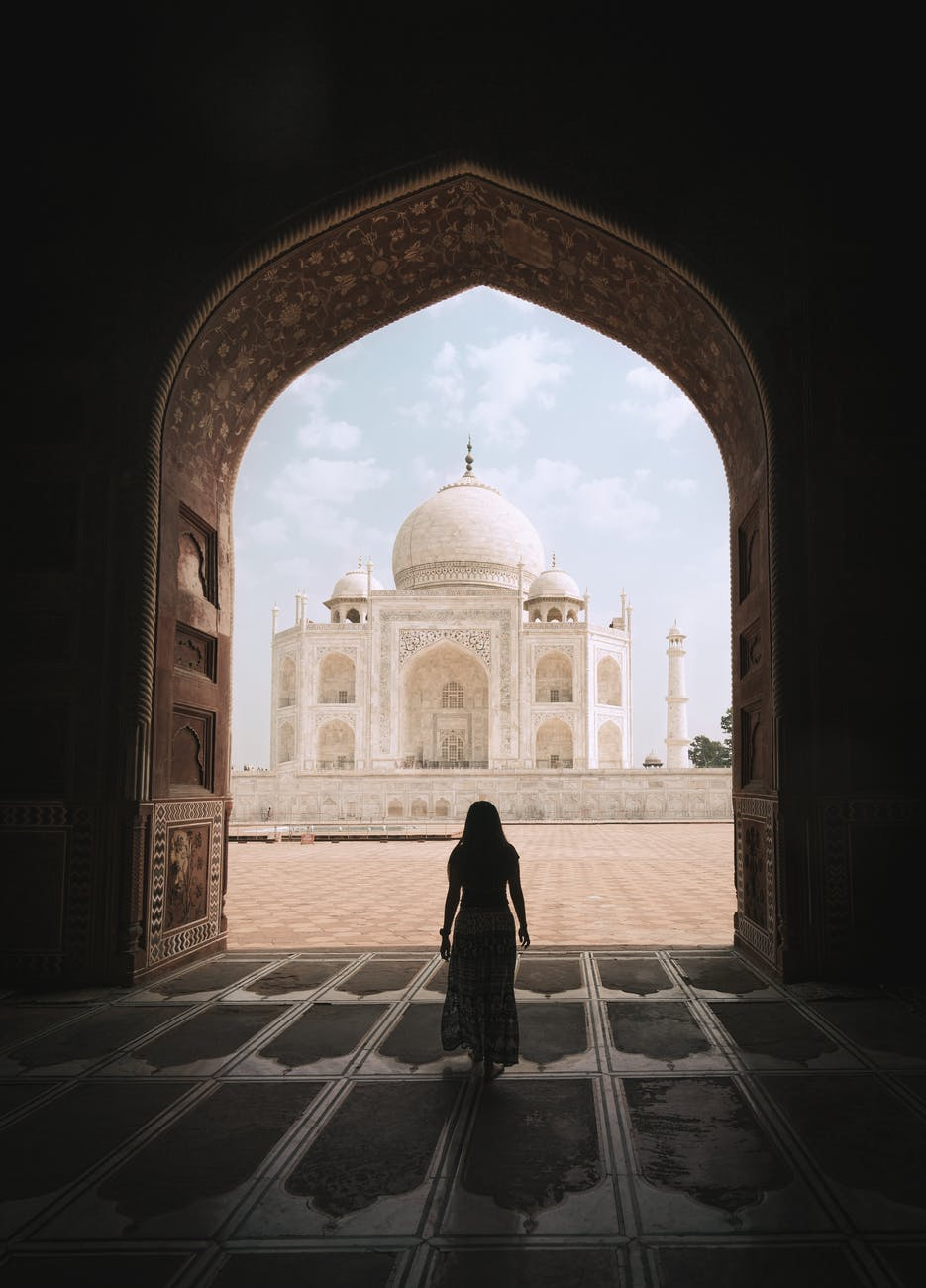 woman admiring majestic famous taj mahal