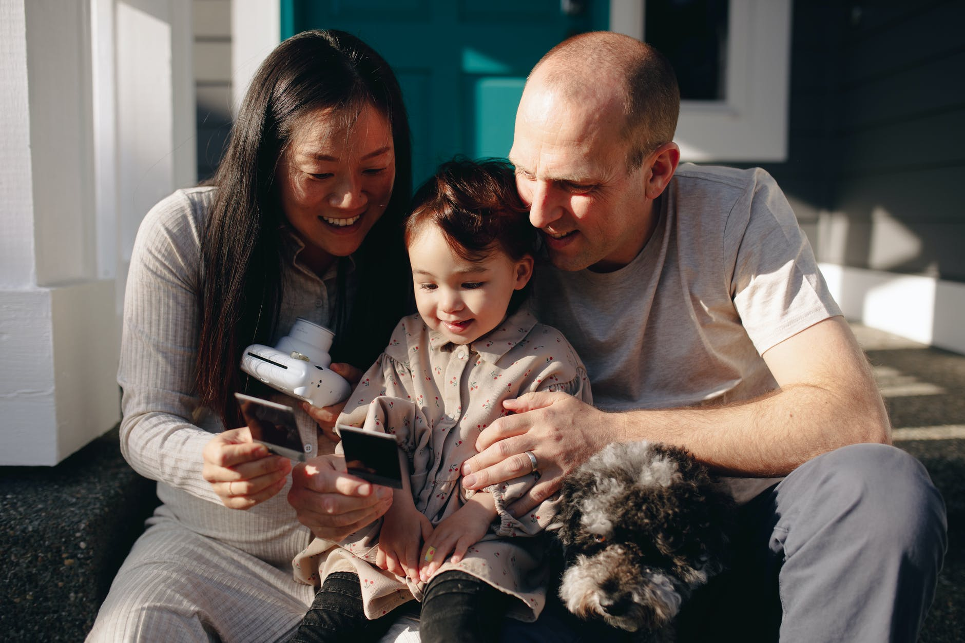 family looking at their instant photos