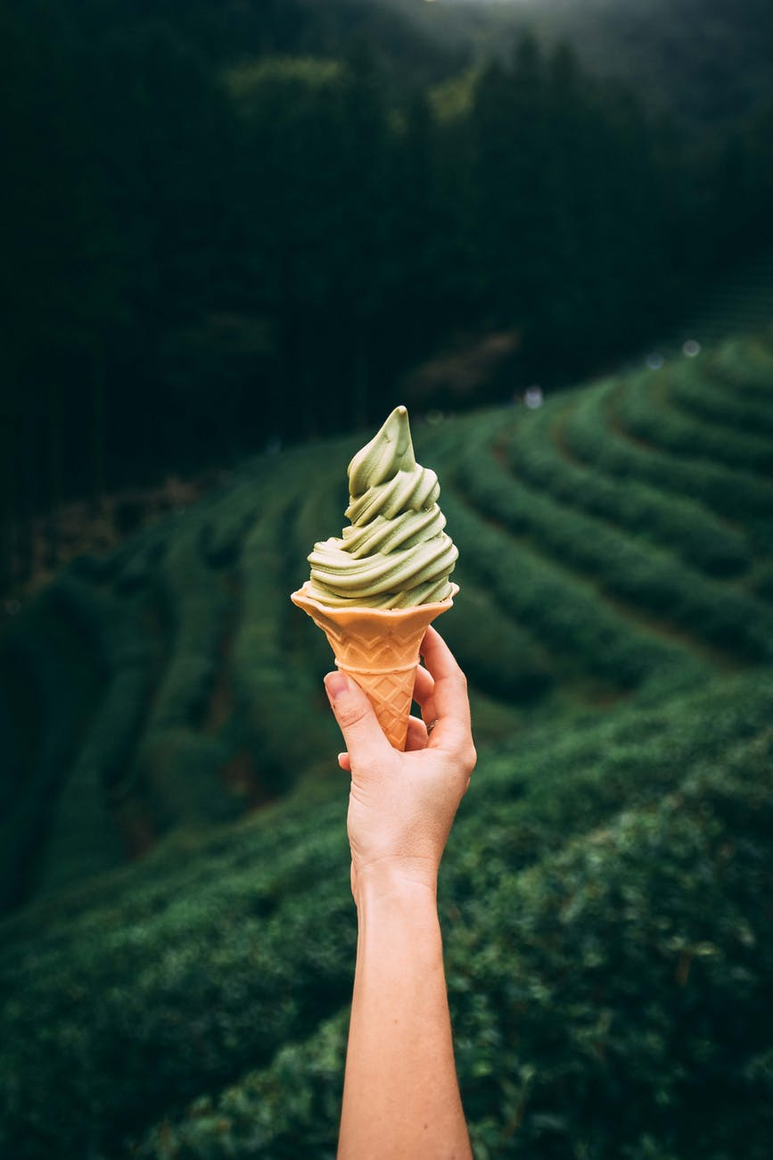 photo of person holding ice cream cone