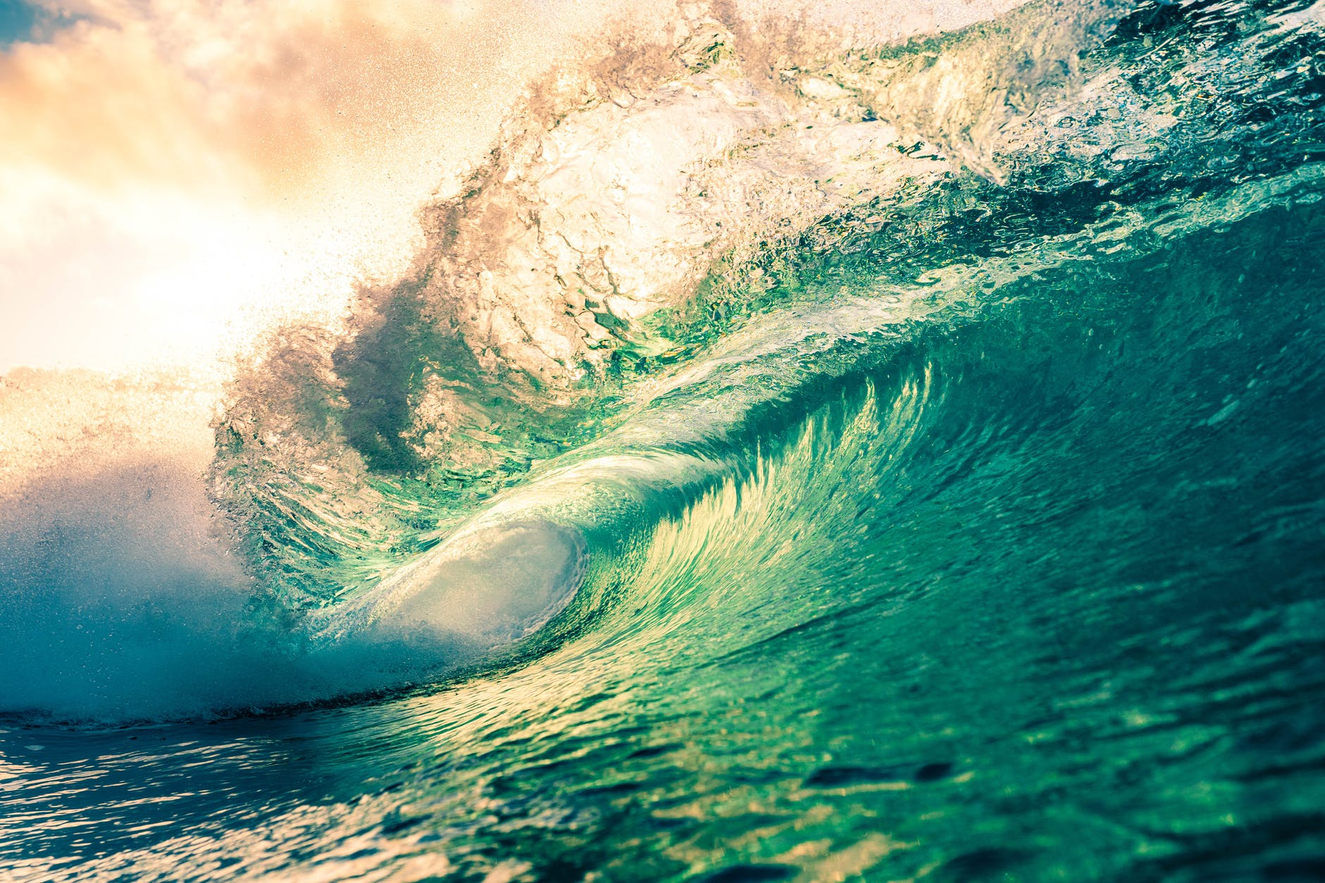 scenic turquoise sea wave under bright sunny sky