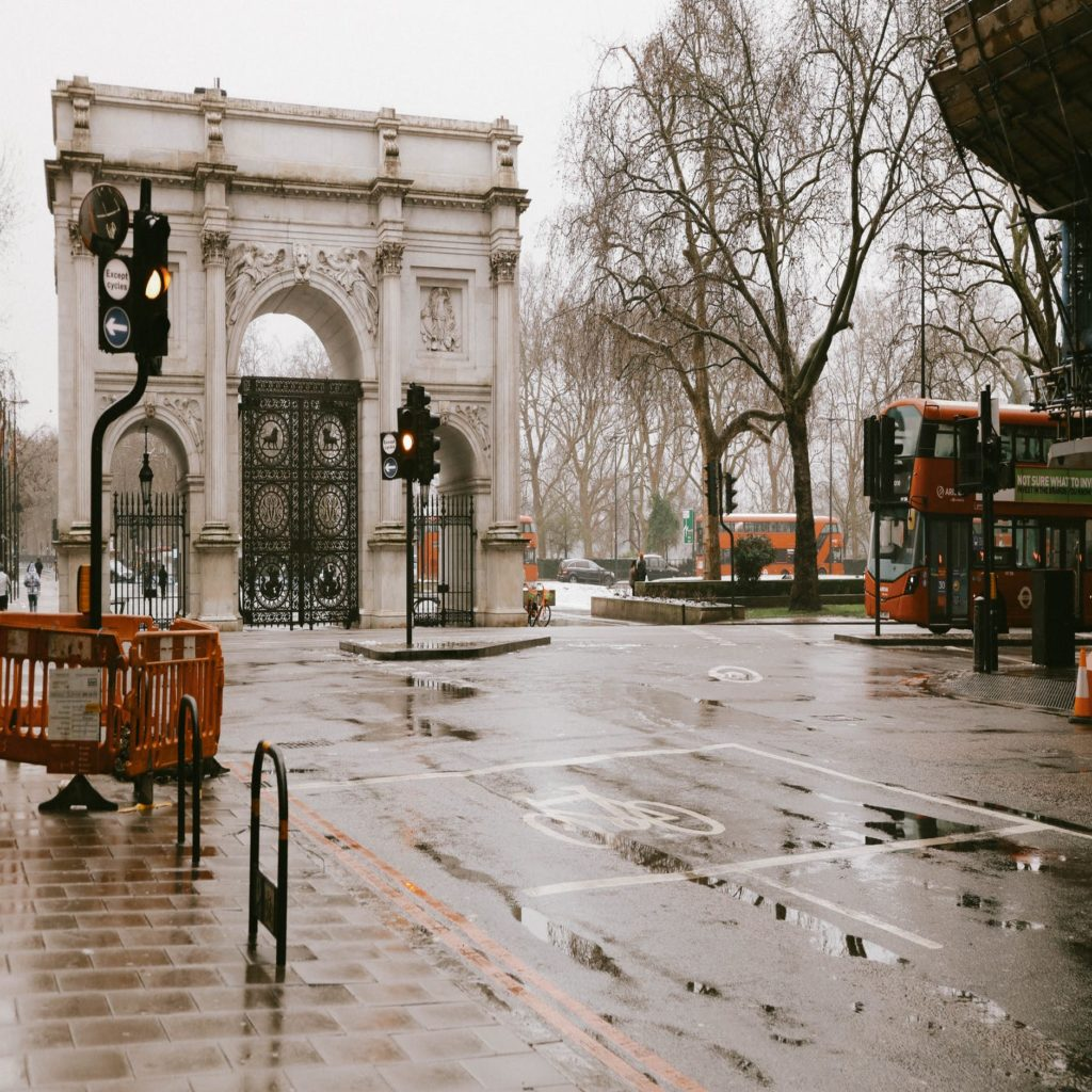 photo of historical marble arch after rain