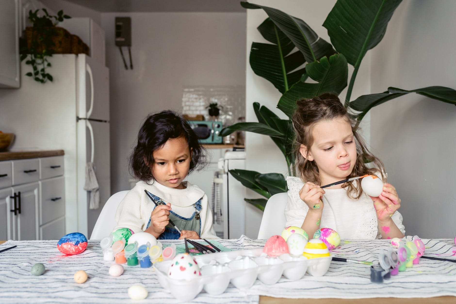 diverse girls painting easter eggs